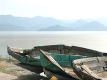 Old boats on the shores of the lake stock image