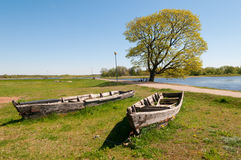 Old boats. Two old boats at the Nemunas river, Rusne island, Lithuania Stock Photography