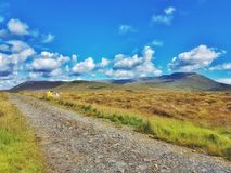 The old bog road. In County Mayo, on the west coast of Ireland, along the wild atlantic way, this deserted bog road stretches into the distance against a deep Stock Photo