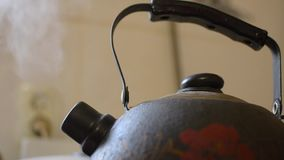 Old boiling kettle on a gas stove stock footage