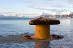 Old bollard in sea or lake Royalty Free Stock Photos