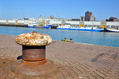 An old bollard on a wharf Stock Images