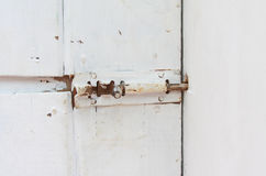 Old bolt with rust the door Stock Image