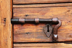 Old bolt on a wooden door Stock Photos