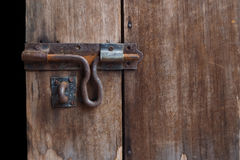 The old bolt at the wooden door. Vintage bolt Stock Image