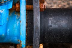 Rust old bolted connection of pipes is close on the side. Old bolted connection of pipes is close on the side royalty free stock image