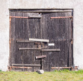 Old bolted wooden gate Stock Photos