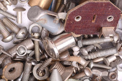 Old bolts, screws and metal details, close up Stock Images