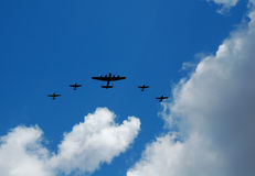 Old bomber and fighter planes. Flying in formation Royalty Free Stock Photos