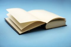 Old book. Short depth-of-field, some sharpness in the closest corner Royalty Free Stock Images