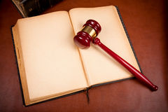 Old book. And gavel on leather desktop Stock Photo