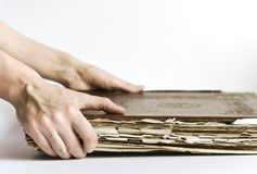 Old book. In hands on white background Royalty Free Stock Images