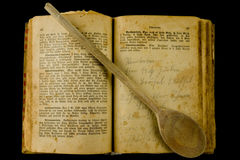 Old book. Old cooobook with a cooking spoon Royalty Free Stock Image