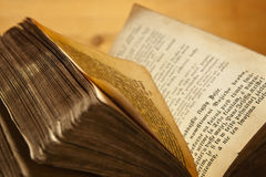 Old book. Old antique book open on wooden background Royalty Free Stock Images