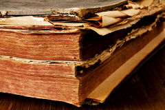 Old book. An old book on a wooden desk Royalty Free Stock Image