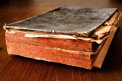 Old book. An old book on a wooden desk Royalty Free Stock Photos