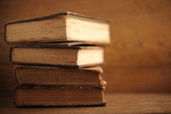 Old book. On wood table close up royalty free stock image
