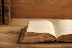 Old book. Open on a wooden table royalty free stock image