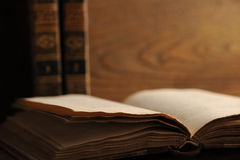 Old book. Open on a wooden table royalty free stock photos
