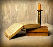 Old Book. And candle on white grunge background Stock Photography