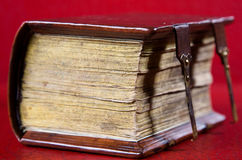An old book. On a red background Stock Photography