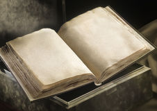 Old book. Opened clear old book laying on a box Royalty Free Stock Photo