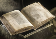 Old book. Opened old book laying on a box Royalty Free Stock Images