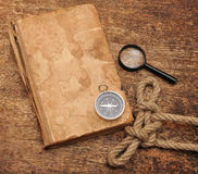 Old Book And Compass Stock Photography