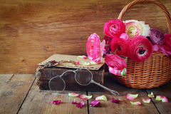 Free Old Book And Glasses Next To Beautiful Field Flowers On Wooden T Royalty Free Stock Images - 70199999