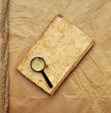 Old Book And Magnifying Glass Stock Images