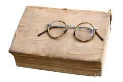Old book with antique glasses Royalty Free Stock Images