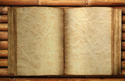 Old book on bamboo. Vintage paper on old bamboo texture Stock Photography