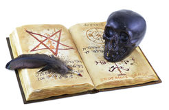 Magic book with black skull Royalty Free Stock Photo
