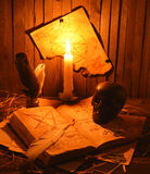 Black skull with pentacle. Old book with black skull and pentacle on the wall Stock Photography