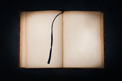 Old book on black stone Stock Images