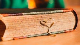 Old book. bookmark ribbon shade Stock Photo