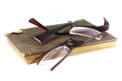 Old book and broken eyeglasses Royalty Free Stock Images