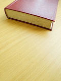 Old book on brown table Royalty Free Stock Images