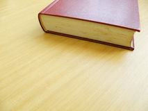 Old book on brown table top Royalty Free Stock Photos