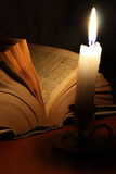 Old book and candle Stock Photography