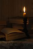 Old book and a candle Royalty Free Stock Image