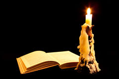 Old book and candle Stock Image