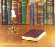 Old book and candle Royalty Free Stock Photos