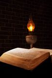 Old book candle lamp Stock Photos