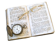 Old book, clock and glasses Stock Photo