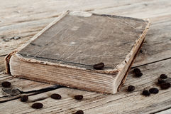 Old book in coffee beans closeup Royalty Free Stock Photo