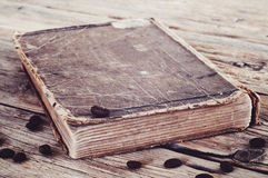 Old book in coffee beans closeup Stock Image