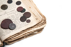 Old book and coins Stock Image