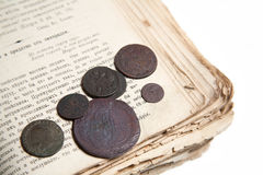 Old book and coins Stock Photo