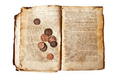 Old book with copper coins Stock Photo